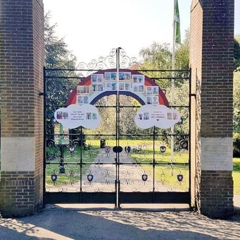 park gates decorated with rainbow drawings